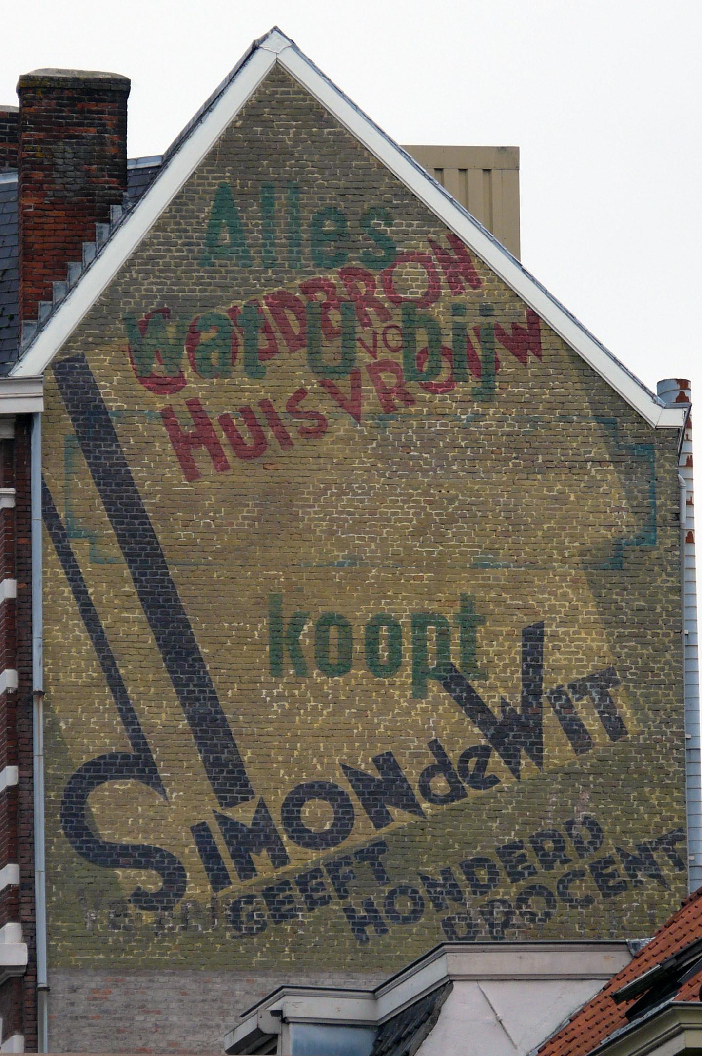 Restauratie gevelreclame Simon de Wit.